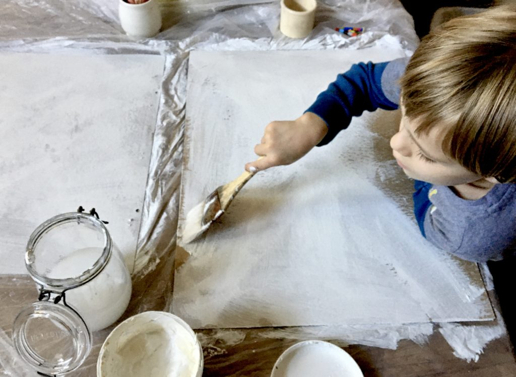 Preparing recycled material as painting surface